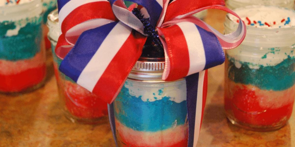 red, white and blue cake in a jar for july 4th