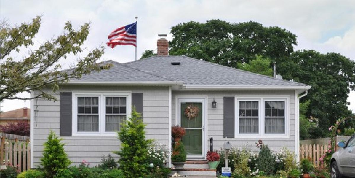 cottage style home with american flag