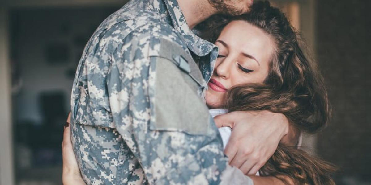 military couple hugging, tips for new military spouses