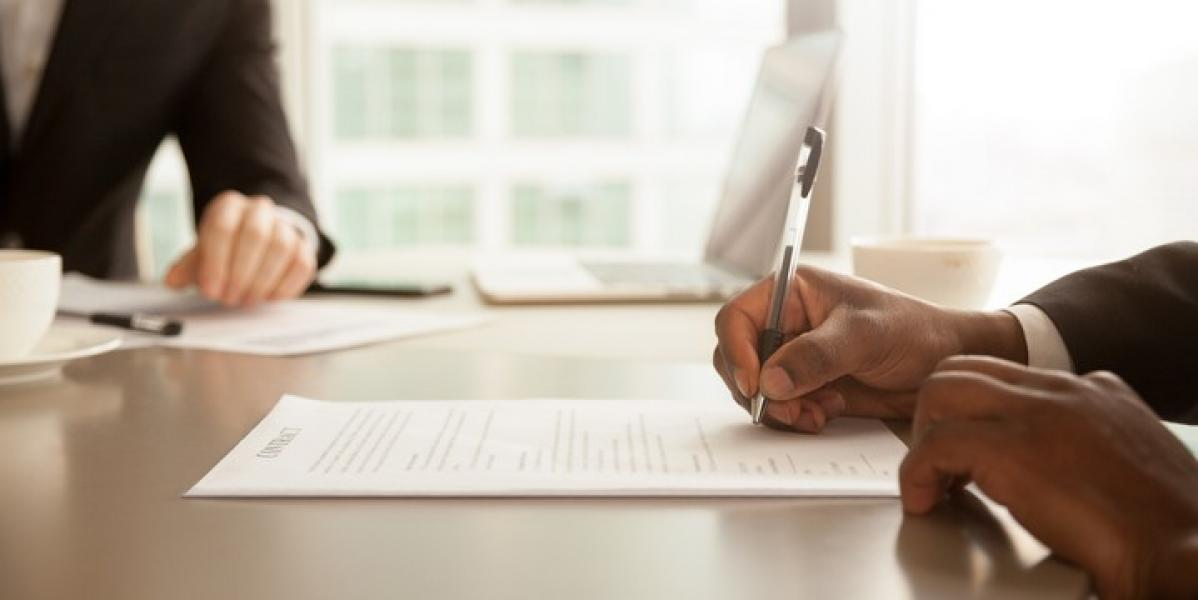 signing the contract on a personal loan to improve credit scores