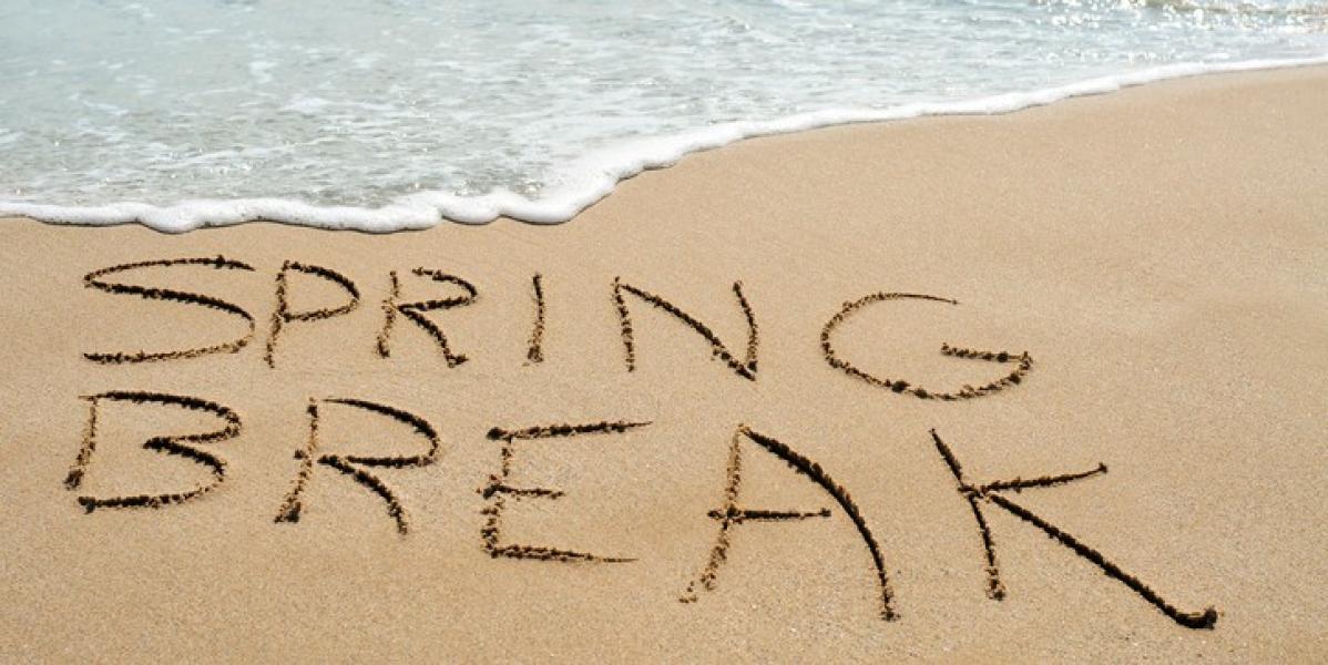 spring break written in the sand of the beach