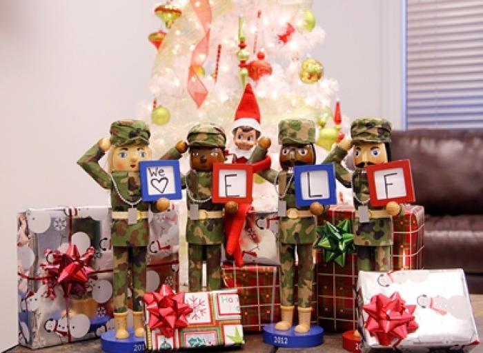 Army themed Nutcrackers pose with Elf on the Shelf.