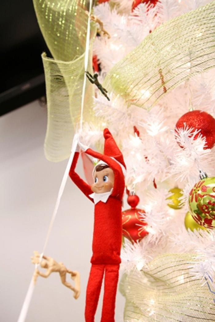 Elf on a Shelf on a Zipline with Toy Soldiers
