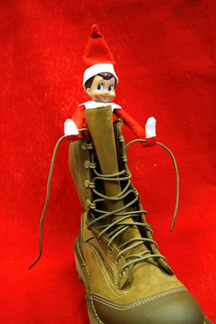 Elf learns to tie up combat boots