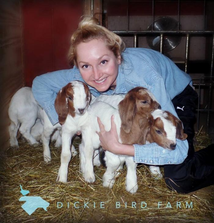 air force veteran ivory embracing her livestock at the Dickie Bird Farm