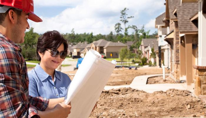 builder meeting woman new home construction
