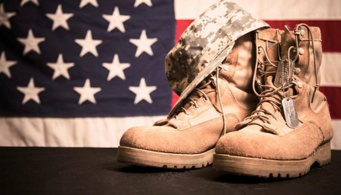 military boots, dog tags, hat and american flag
