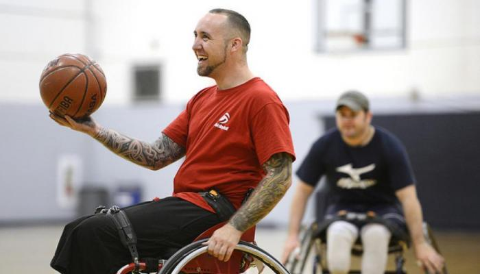 wheelchair basketball being played by two athletes